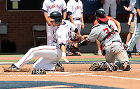 Virginia outfielder Mike Papi (38) is tagged out Maryland catcher Kevin Martir (32) in the first inning of an NCAA college baseball tournament super regional game against Maryland in Charlottesville, Va., Saturday, June 7, 2014. Maryland defeated Virginia 5-4. (AP Photo/Andrew Shurtleff)