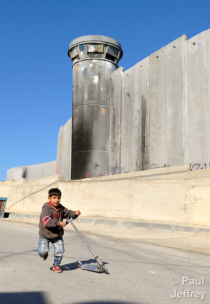 A Palestinian boy plays in front of the Israeli separation barrier which has sealed off Bethlehem from nearby Jerusalem.