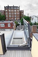 An open skylight window, leading to a roof terrace.