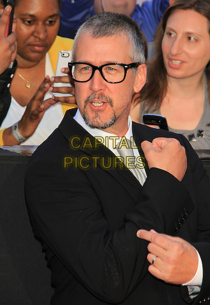 Alan Ruck<br /> The New York Premiere of &quot;World War Z&quot; in Times Square, New York, NY., USA.<br /> June 17th, 2013<br /> half length mouth open hand arm black suit white shirt grey gray tie glasses goatee facial hair<br /> CAP/LNC/TOM<br /> &copy;LNC/Capital Pictures