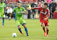 August 10, 2013: Seattle Sounders FC forward Clint Dempsey #2 and Toronto FC midfielder Jonathan Osorio #21 in action during an MLS regular season game between the Seattle Sounders and Toronto FC at BMO Field in Toronto, Ontario Canada.<br /> Seattle Sounders FC won 2-1.