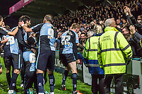 Goalscorer Jason McCarthy of Wycombe Wanderers celebrates with the crowd  during the Sky Bet League 2 match between Wycombe Wanderers and Oxford United at Adams Park, High Wycombe, England on 19 December 2015. Photo by Andy Rowland.