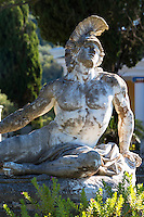 Stone statue of reclining figure of Dying Achilles (Achilleas thniskon) at Achilleion Palace, Museo Achilleio, in Corfu, Greece