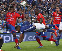 BOGOTÁ- COLOMBIA,25-05-2019:Alex Rambal (Der.) jugador de Millonarios disputa el balón con Mairon Quiñones (Izq.) jugador del  Deportivo Pasto durante el cuarto  partido de los cuadrangulares finales de la Liga Águila I 2019 jugado en el estadio Nemesio Camacho El Campín de la ciudad de Bogotá. /Alex Rambal (R) player of Millonarios fights the ball  against of Mairon Quinones(L) player of Deportivo Pasto during the fourth match for the quarter finals B of the Liga Aguila I 2019 played at the Nemesio Camacho El Campin stadium in Bogota city. Photo: VizzorImage / Felipe Caicedo / Staff
