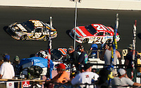 Ryan Newman (39) and  Trevor Bayne (21) race past fans during the Daytona 500, Daytona International Speedway, Daytona beach, Florida, February 20, 2011.  (Photo by Brian Cleary/www.bcpix.com)