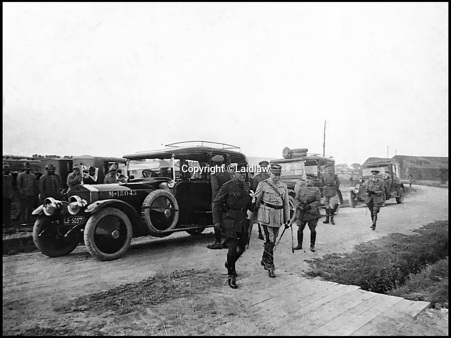 BNPS.co.uk (01202 558833)Pic: Laidlaw/BNPS<br /> <br /> Haig and Foch near the Western Front - Pte Smiths's Rolls Royce is in the background.<br /> <br /> A fascinating archive of photographs and momentoes of the WW1 chauffeur to British commander Field Marshall Douglas Haig has been unearthed and includes previously unseen images of the Allied leaders.<br /> <br /> The items belonged to Private John Smith of the GHQ (Army General Headquarters) 1st Echelon who was the chauffeur for both Haig and his predecessor as commander of the British Expeditionary Force Sir John French.<br /> <br /> The 16in by 10in cotton pennant bears the inscription 'first flag flown by Sir D Haig when C in C', which refers to Haig being Commander in Chief of the BEF. <br /> <br /> Pte Smith's items include several rare photos of Haig with French general Marshal Ferdinand Foch as well as images of himself and fellow staff car drivers.<br /> <br /> The archive sold for £2300 st Laidlaws in Carlisle.
