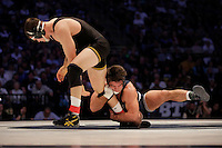 STATE COLLEGE, PA - FEBRUARY 8: Nathan Burak of the Iowa Hawkeyes and Morgan McIntosh of the Penn State Nittany Lions during their match on February 8, 2015 at the Bryce Jordan Center on the campus of Penn State University in State College, Pennsylvania. The Hawkeyes won 18-12. (Photo by Hunter Martin/Getty Images) *** Local Caption *** Nathan Burak;Morgan McIntosh