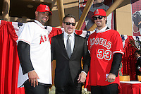 Albert Pujols, Angels Owner Arte Moreno, and C.J. Wilson at press conference introducing Pujols and Wilson as new members of the Los Angeles Angels at Angel Stadium on December 10, 2011 in Anaheim,California.(Larry Goren/Four Seam Images)