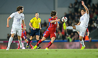 PRAGUE, Czech Republic - September 3, 2014: USA's Mix Diskerud (L), Alejandro Bedoya (R) and Tomas Rosicky of the Czech Republic during the international friendly match between the Czech Republic and the USA at Generali Arena.