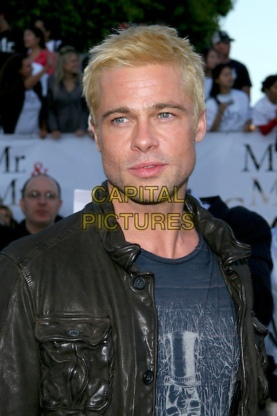 "BRAD PITT.At the ""Mr. & Mrs. Smith"" World Premiere held at Mann Village Theatre, Hollywood, CA, .USA, 7 June 2005..half length bleached blonde dyed hair beard stubble black leather jacket blue t-shirt t shirt.Ref: ADM.www.capitalpictures.com.sales@capitalpictures.com.©Jacqui Wong/AdMedia/Capital Pictures."