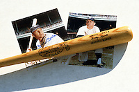 Mickey Mantle autographed 8x10 photos underneath a name model Louisville Slugger bat during the Mickey Mantle-Whitey Ford Fantasy Camp circa November 1990 at Fort Lauderdale Stadium in Ft. Lauderdale, Florida.  (MJA/Four Seam Images)