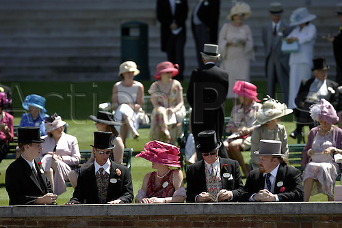 15 June 2004: Racegoers in the Royal Enclosure at Royal Ascot Photo: Steve Bardens/Action Plus...horse racing 040615 fashion hat hats wall