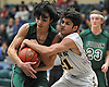 Julian Alfaro #10 of Carle Place, left, and Bradley Beck #21 of Oyster Bay wrestle for possession during the Nassau County varsity boys basketball Class B semifinals at Farmingdale State College on Sunday, Feb. 18, 2018. Oyster Bay won by a score of 68-52.