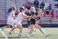 College Park, MD - April 27, 2019: John Hopkins Bluejays Maggie Schneidereith (6) gets pushed by Maryland Terrapins defender Shelby Mercer (2) during the game between John Hopkins and Maryland at  Capital One Field at Maryland Stadium in College Park, MD.  (Photo by Elliott Brown/Media Images International)
