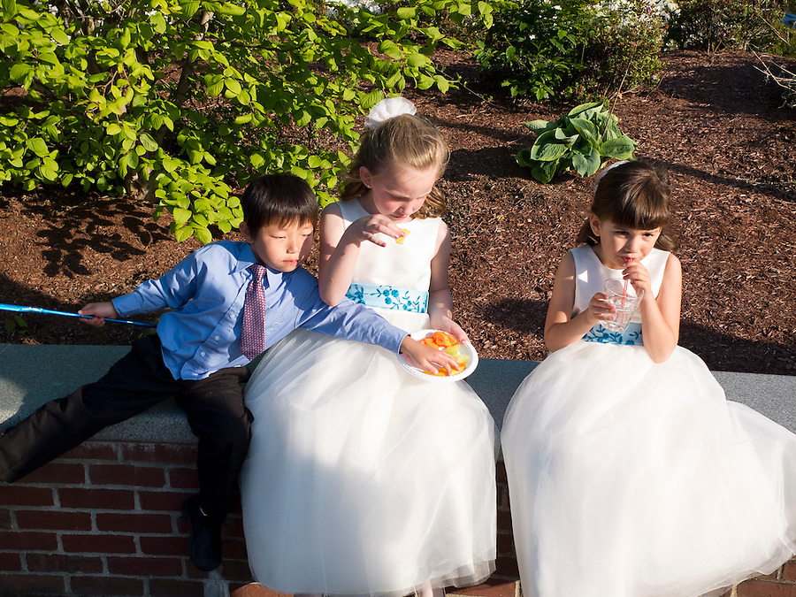 Holden Miller, 4, is pictured with cousins and flower girls McKenzie Stute and Serafina Burns as family and friends gather to celebrate the wedding of Hannah Kurtis and Erik Tejero, and subsequent reception at the Garden House, at Look Park in Northampton, Mass., on May 12, 2012.
