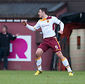 Motherwell's John Sutton celebrates after thinking he's scored their first goal. Referee Craig Thomson gave the goal before chalking it off after consulting his stand side assistant.
