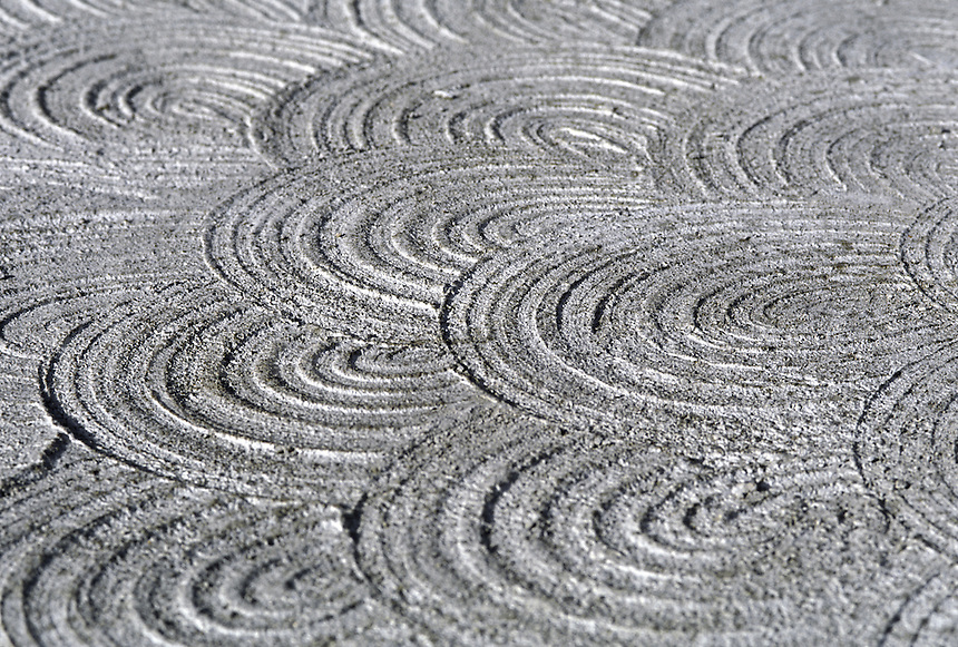 Patterns in the finishing process of a concrete pad. California.
