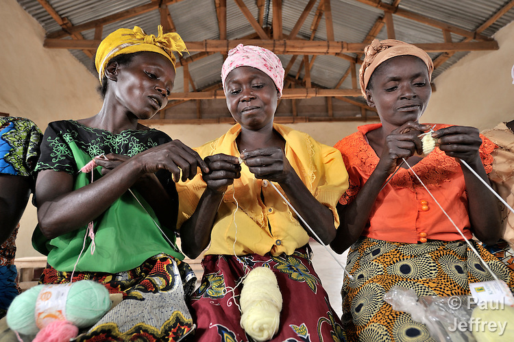 Women in Mwitobwe, a village in the Democratic Republic of the Congo, learn sewing and knitting skills in a workshop supported by United Methodist Women. The program involves skills training and literacy classes.