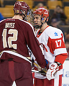 Kevin Hayes (BC - 12), Evan Rodrigues (BU - 17) get close while waiting for a faceoff. - The Boston College Eagles defeated the Boston University Terriers 3-1 (EN) in their opening round game of the 2014 Beanpot on Monday, February 3, 2014, at TD Garden in Boston, Massachusetts.
