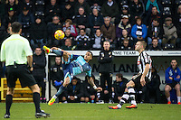 Paris Cowan-Hall of Wycombe Wanderers hits the ball forward past Louis Laing of Notts Co during the Sky Bet League 2 match between Notts County and Wycombe Wanderers at Meadow Lane, Nottingham, England on 10 December 2016. Photo by Andy Rowland.
