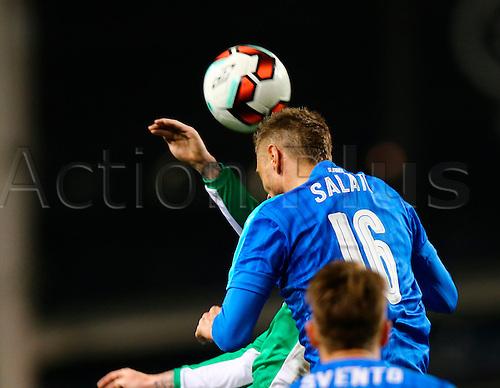 29.03.2016. Aviva Stadium, Dublin, Ireland. International Football Friendly Rep. of Ireland versus Slovakia. <br /> Kornel Salata (Slovakia) head clear over James McClean (Rep. of Ireland).