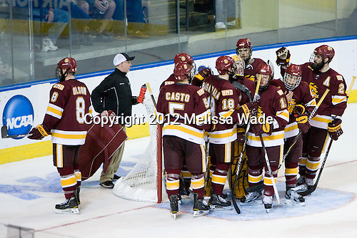 "Dale ""Hoagie"" Haagenson (Duluth - Manager) retrieve's Reiter's water bottle as the players gather following the final whistle. - The Boston College Eagles defeated the University of Minnesota Duluth Bulldogs 4-0 to win the NCAA Northeast Regional on Sunday, March 25, 2012, at the DCU Center in Worcester, Massachusetts."
