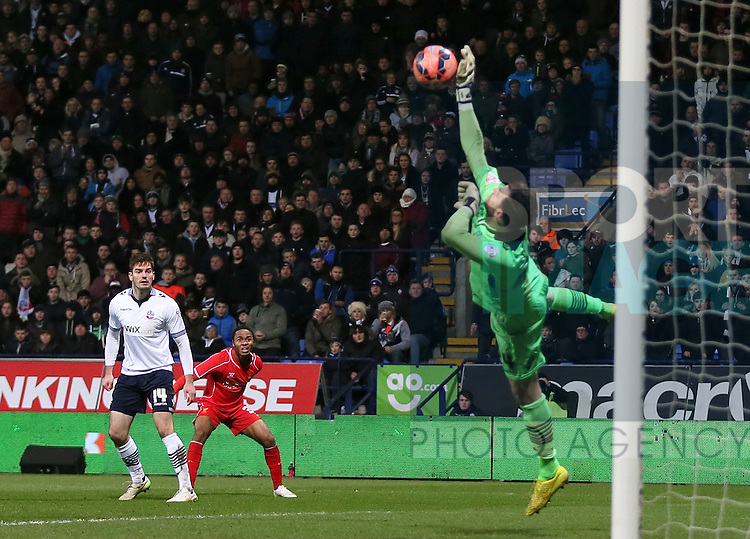 Andrew Lonegan of Bolton makes a save from a shot by Raheem Sterling of Liverpool - FA Cup Fourth Round replay - Bolton Wanderers vs Liverpool - Macron Stadium  - Bolton - England - 4th February 2015 - Picture Simon Bellis/Sportimage