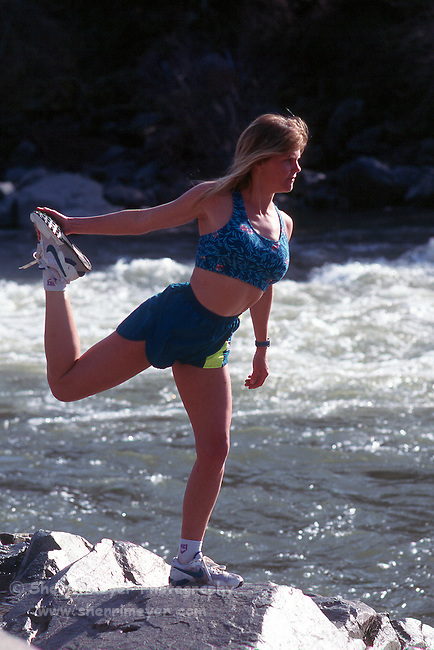 Runner stretching before a run along the American River