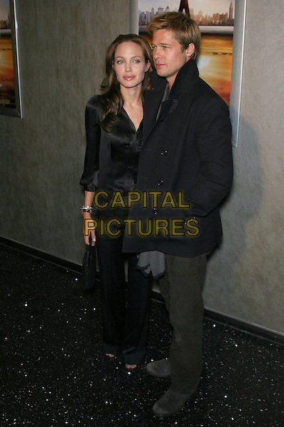 "ANGELINA JOLIE & BRAD PITT.""God Grew Tired of Us"" Los Angeles Premiere - Arrivals held at The Pacific Design Center, Los Angeles, California, USA, 8 January 2007..full length black shirt blouse couple trousers bag.CAP/ADM/ZL.©Zach Lipp/Admedia/Capital Pictures"