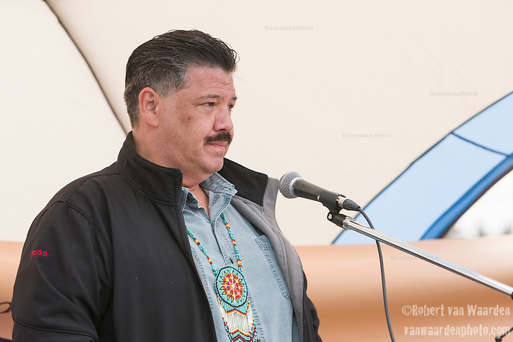 Russ Letica from Madawaska First Nation speaks at the rally for the End of the Line. On May 30, 2015, over 500 Canadian citizens and First Nations marched in Red Head, Saint John, at the End of the Line for the proposed Energy East pipeline. The people were protesting the proposed mega pipeline and the tank terminal that would destroy and the Red Head community and endanger the Bay of Fundy. If approved, TransCanada's Energy East pipeline would travel 4600km from Alberta to Saint John, New Brunswick, shipping 1.1 million barrels of crude oil and bitumen for export through the Bay of Fundy, a critical habit for Right whales and home to thousands of jobs in Tourism and Fishing.