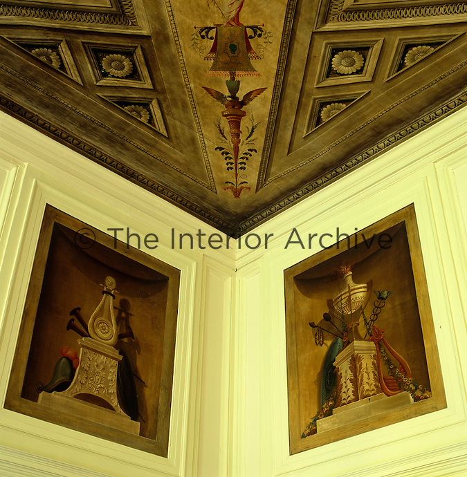 A trompe l'oeil ceiling is matched by panels on the wall depicting musical instruments