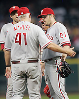 Phillies pitcher Adam Easton (21) meets with Manager Charlie Manuel on Friday May 23rd at Minute Maid Park in Houston, Texas. Photo by Andrew Woolley / Four Seam Images.