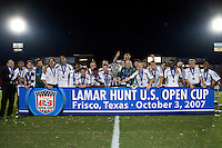 New England Revolution players and coaches celebrate with the Lamar Hunt U.S. Open Cup trophy.  New England Revolution defeated FC Dallas 3-2 to capture the 2007 Lamar Hunt U.S. Open Cup at Pizza Hut Park in Frisco, TX on October 3, 2007.