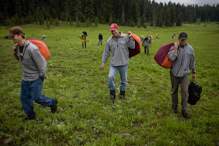 Veterans Travis Dotson, Steve Beirman and Pete Dutchek lug their jump gear out of Bear Basin after a successful proficiency jump near the McCall Smokejumper base in McCall, ID.