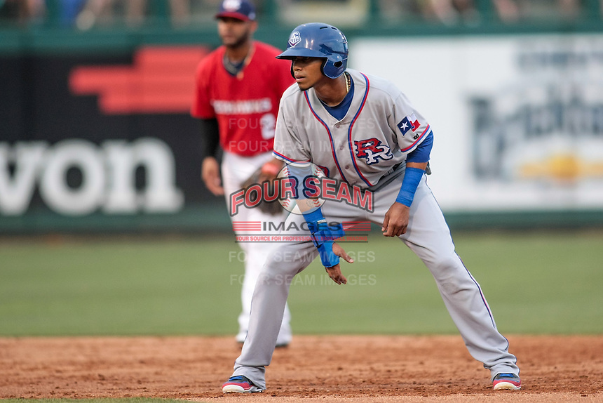 Engel Beltre (7) of the Round Rock Express leads off second base during the Pacific Coast League game against the Oklahoma City RedHawks at Chickashaw Bricktown Ballpark on June 14, 2013 in Oklahoma City ,Oklahoma.  (William Purnell/Four Seam Images)
