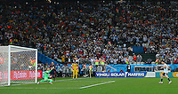 Lionel Messi of Argentina scores his penalty during the shootout