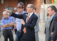 NWA Democrat-Gazette/ANDY SHUPE<br /> Peter Lane (center), president and CEO of the Walton Arts Center, speaks Tuesday, Sept. 22, 2015, alongside David Swain (left), owner representative, during a tour of the new administrative offices being constructed as part of Fayetteville&rsquo;s $12.3 million municipal parking deck project. The arts center contributed more than $2.2 million to the project which will house administrative staff and include additional back-of-house space for the performing arts center. Visit nwadg.com/photos to see more photographs from the tour.
