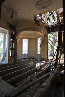 The interior of one of the Grand Dames of beautiful old buildings being demolished after suffering from Hurricane Katrina's wind damage located at 1514 St Charles Avenue at Melpomene Avenue in New Orleans, Louisiana. The owners apparently thought it was better to tear it completely down rather than attempting to restore this beautiful old building. Today, it sits as an empty lot.