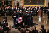 As members of the Bush family and other dignitaries look on, the casket containing the remains of former United States President George H.W. Bush is set on the Lincoln Catafalque in the Rotunda of the US Capitol during the ceremony honoring the former President, who will Lie in State in the Rotunda of the US Capitol on Monday, December 3, 2018.<br /> Credit: Ron Sachs / CNP<br /> (RESTRICTION: NO New York or New Jersey Newspapers or newspapers within a 75 mile radius of New York City)