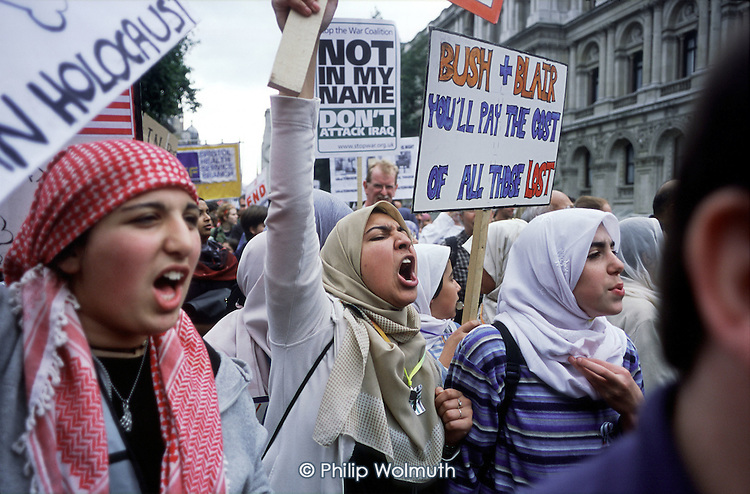 Young Muslims shout in support of Palestinians on an Anti-war Coalition demonstration against war in Iraq.
