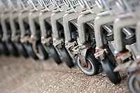 A row of hopping trolleys' wheels at a Morrisons super market