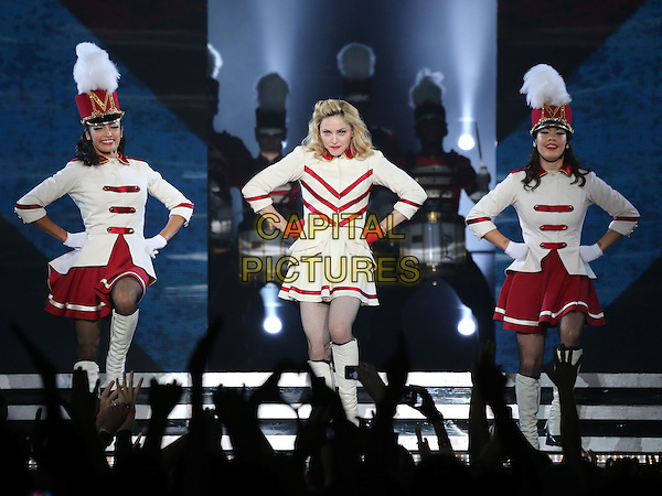 Madonna (Madonna Louise Ciccone) .Madonna performs at The Grand Garden Arena inside the MGM Grand Hotel and Casino, Las Vegas, Nevada, USA, .13th October 2012..music concert gig show live on stage performing full length red white cheerleader outfit costume knee high  boots baton hands on hips  collar gloves .CAP/ADM/MJT.© MJT/AdMedia/Capital Pictures.