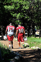 Jul 30, 2008; Flagstaff, AZ, USA; Arizona Cardinals tackle (75) Levi Brown and linebacker (56) Chike Okeafor head back to the locker room following training camp on the campus of Northern Arizona University. Mandatory Credit: Mark J. Rebilas-