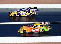 Apr. 1, 2011; Las Vegas, NV, USA: NHRA funny car driver Ron Capps (top) races alongside Bob Bode during qualifying for the Summitracing.com Nationals at The Strip in Las Vegas. Mandatory Credit: Mark J. Rebilas-