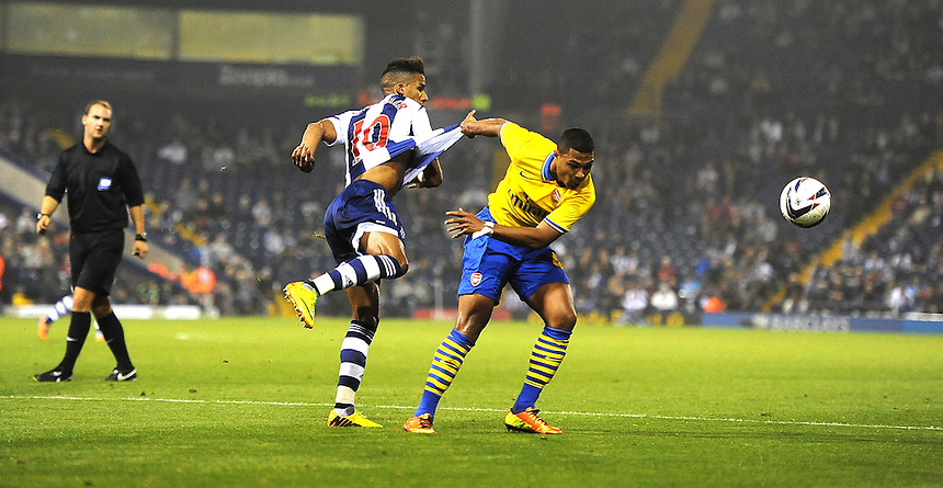 Arsenal's Per Mertesacker clashes with West Bromwich Albion's Scott Sinclair<br /> <br /> Photo by Stephen White/CameraSport<br /> <br /> Football - Capital One Cup Third Round - West Bromwich Albion v Arsenal - Wednesday 25th September 2013 - The Hawthorns - West Bromwich<br />  <br /> &copy; CameraSport - 43 Linden Ave. Countesthorpe. Leicester. England. LE8 5PG - Tel: +44 (0) 116 277 4147 - admin@camerasport.com - www.camerasport.com