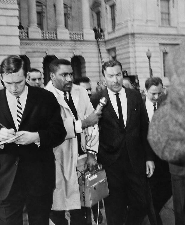 Rep. Adam Clayton Powell, D-N.Y. standing outside on Capitol Hill. (Photo by Dev O'Neill/CQ Roll Call)