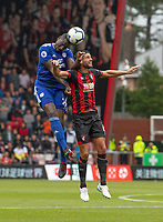 Cardiff City's Sol Bamba (left) battles with Bournemouth's Andrew Surman (right) <br /> <br /> Photographer David Horton/CameraSport<br /> <br /> The Premier League - Bournemouth v Cardiff City - Saturday August 11th 2018 - Vitality Stadium - Bournemouth<br /> <br /> World Copyright &copy; 2018 CameraSport. All rights reserved. 43 Linden Ave. Countesthorpe. Leicester. England. LE8 5PG - Tel: +44 (0) 116 277 4147 - admin@camerasport.com - www.camerasport.com