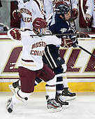 Cam Spiro (BC - 15), Connor Hardowa (UNH - 2) - The Boston College Eagles and University of New Hampshire Wildcats tied 4-4 on Sunday, February 17, 2013, at Kelley Rink in Conte Forum in Chestnut Hill, Massachusetts.