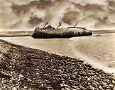 MEXICO, Baja, shipwrecked boat with dramatic clouds, San Quintin (B&W)