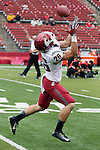 Tyler Baker, Washington State University wide receiver, warms up prior to the Cougars first road test of the season against Big Ten foe Rutgers at High Point Solutions Stadium in Piscataway, New Jersey, on September 12, 2015.  WSU came back from a late deficit to go on a 90 yard touchdown drive to score the winning TD with 13 seconds left to get the win, 37-34.